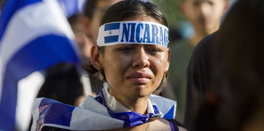 Una joven llora durante una marcha para exigir la liberación de jóvenes detenidos en las protestas contra el presidente Daniel Ortega, en Managua, Nicaragua / El Nuevo Diario,Nicaragua