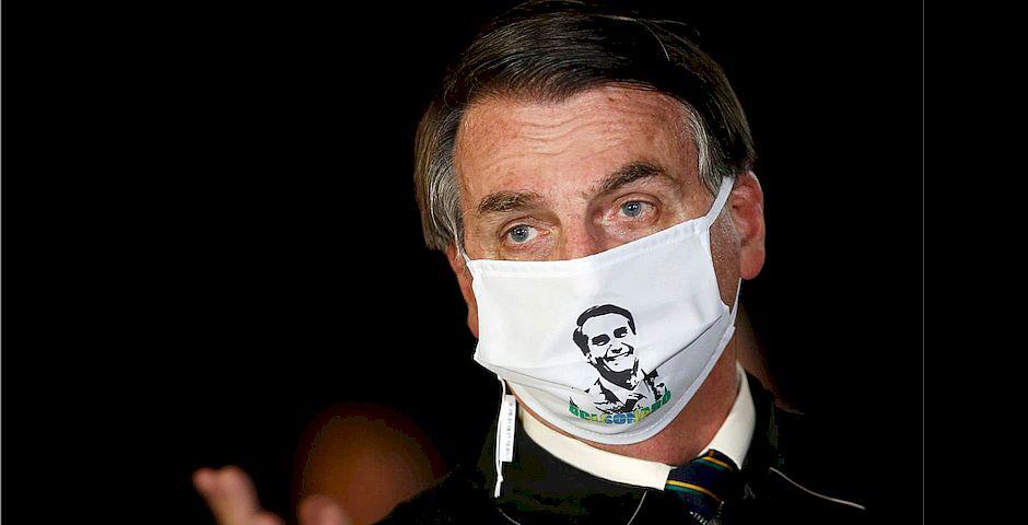 Jair Bolsonaro con mascarilla en rueda de prensa el 22 de mayo. Adriano Machado / Reuters,Bolsonaro